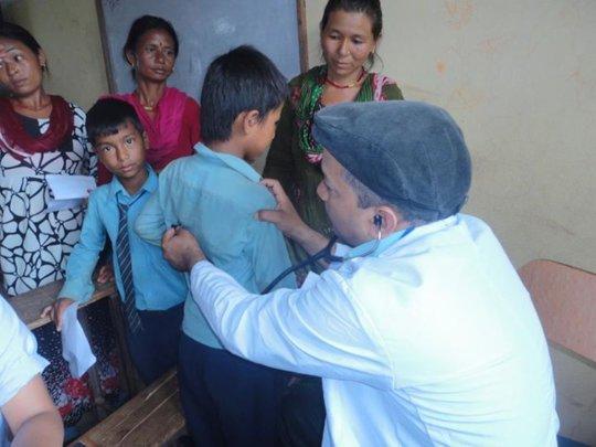 Doctor checks a boy's vital signs