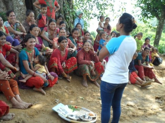 Educator teaching mothers on proper nutrition