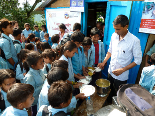 Feeding children at one of the community kitchens