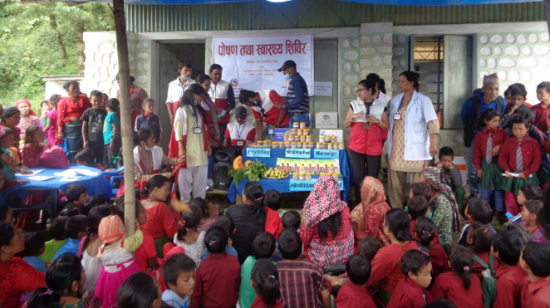 Children and mothers at a nutrition outreach camp