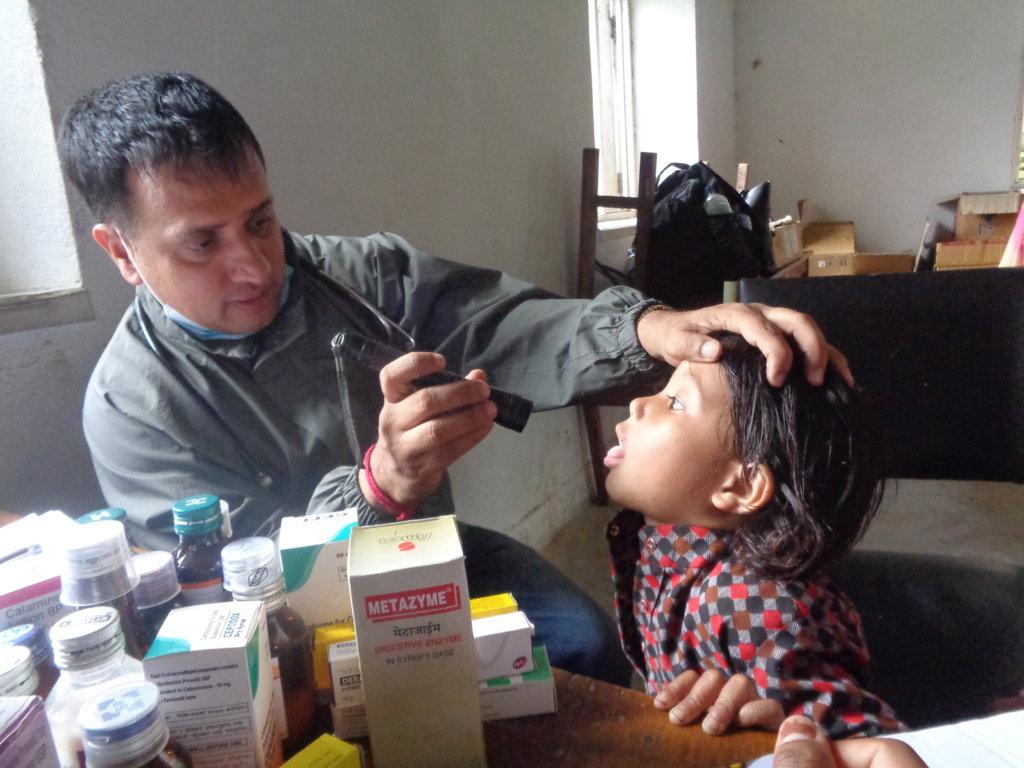 Say ahh...Young Nepali girl gets a checkup