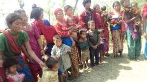 Women and children at an outreach camp