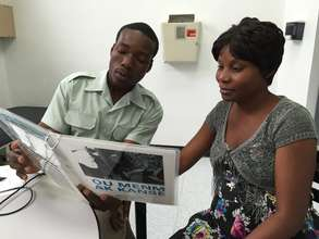 A social worker in Haiti using CEMs with a patient