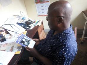 Dr. Mugambe (Uganda) w/GO's patient education tool