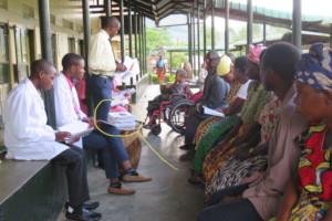 Using GO's CEM booklet w/patients in Bwindi,Uganda