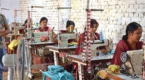 Former Kamlari at sewing class