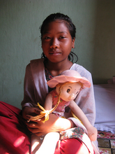 Now she is free from slavery and goes to school