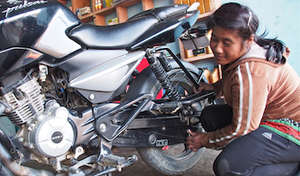 This former child slave owns her own repair shop