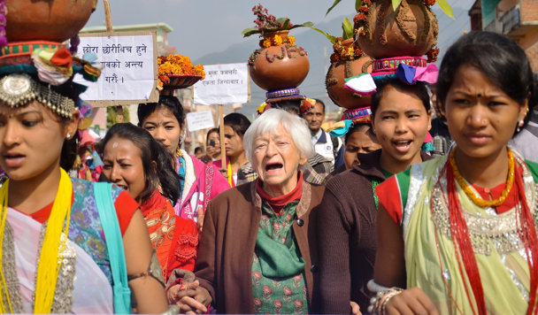 Olga Murray marching with freed Kamlari