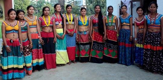 Former Kamlari model their traditional attire