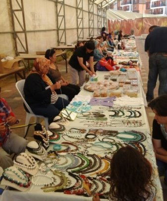 Microentrepreneur women selling products at bazaar