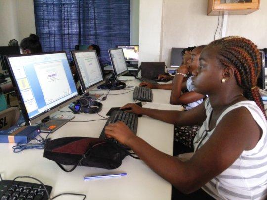 Ladies working on their powerpoint presentations