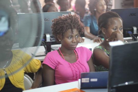 Ladies attentively watching video tutoriala