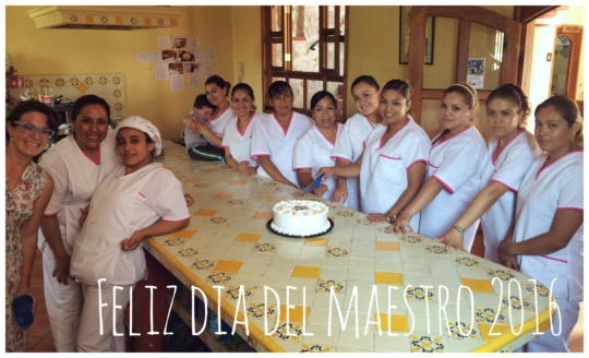 Celebrating Dia de Maestras with cake.