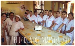 Celebrating Dia de Maestras with cake.