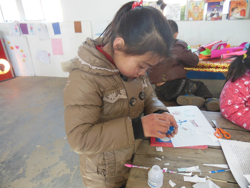 A student concentrates on her blueprint.