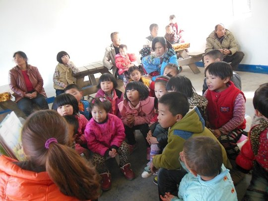 Rural parents and children gather for story time.