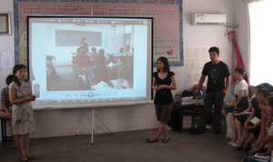 A rural Chinese teacher presents on her teaching.