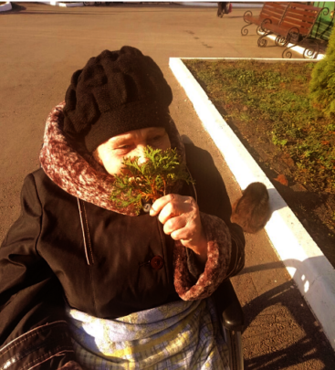 Tatiana with a small pine twig
