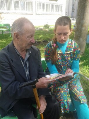 Anna, our assistant, reads with a granddad