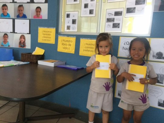 Two girls presented their own books
