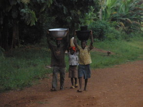 People carrying water from the local water pump