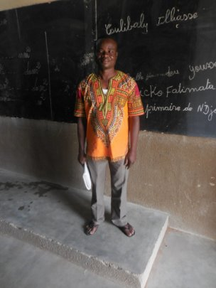 Teacher of the primary school in Djomga