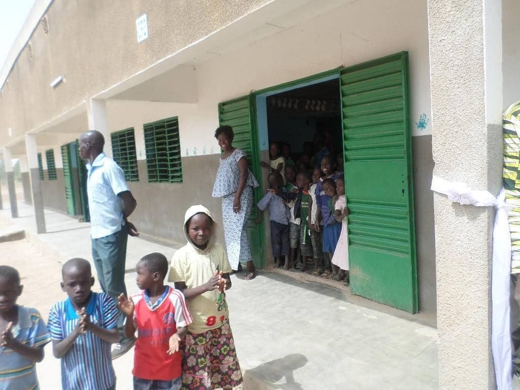 Teacher and students exiting classroom