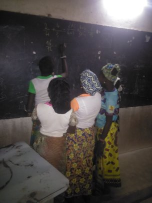 Girls studying at night, Djomga primary school