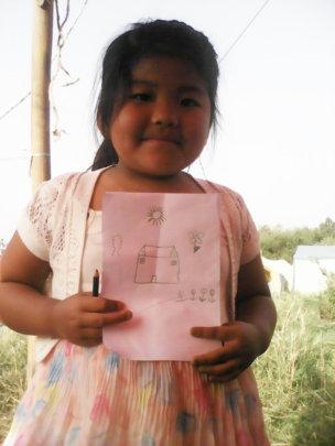 Girl proudly displays her art, Copyright CAP Nepal