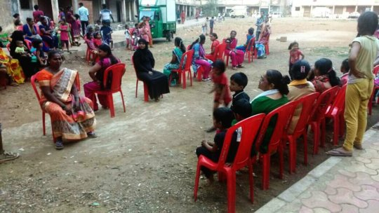 Local women and children playing musical chair