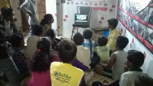 Children watching documentary