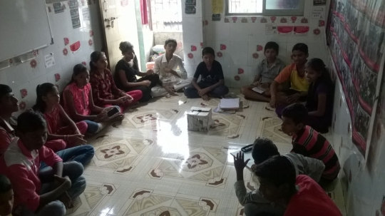 Children having discussions after watching film