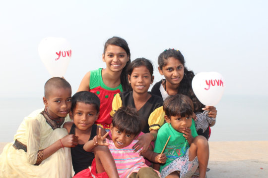 Youth and children holding balloons for awareness