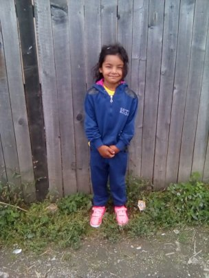 Mirabela with new shoes and warm clothes
