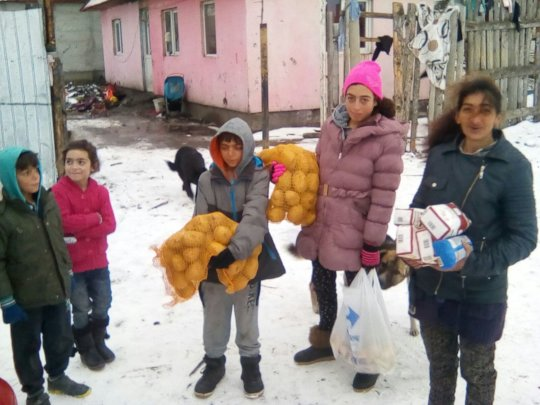 Distributing food to the families in the snow