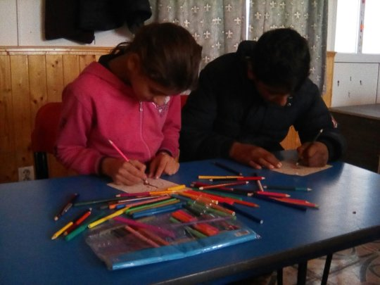 Concentrating on their work