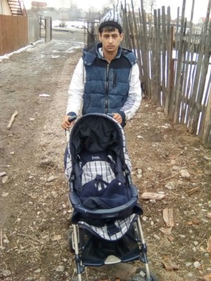 New Dad with buggy donated by Refugiu