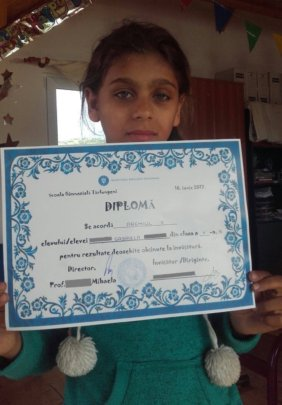 Gabriela with her certificate from school