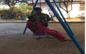 Patient as kid on the swing at hospice