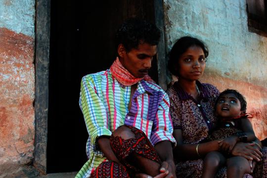 Sreemanthini with her parents.JPG