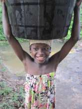 young girl collecting water