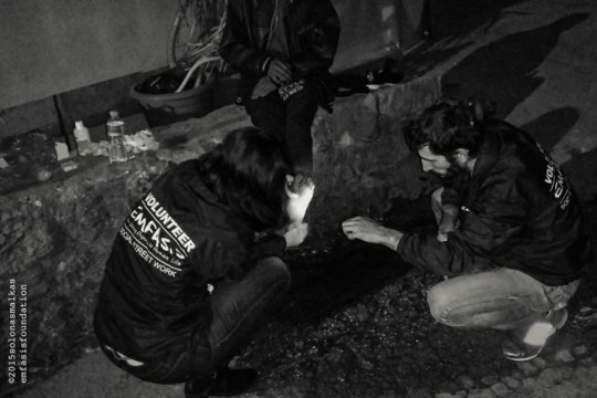 Offering first aid to o homeless young man - II