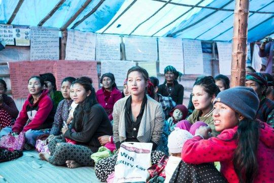 Women gather in our FFS in Damgade.