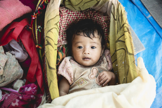 A baby girl in our Alchi Danda shelter.