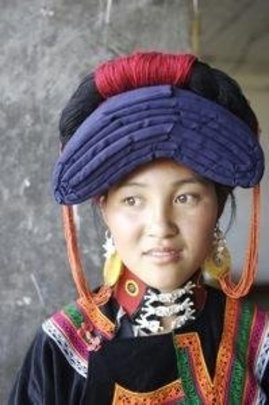 Young woman in traditional Yi costume