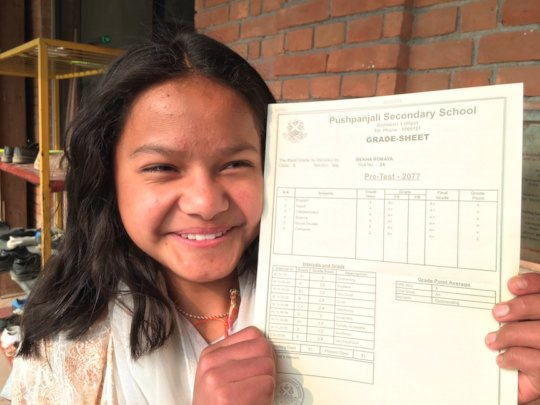 Rekha with her Perfect Report Card!