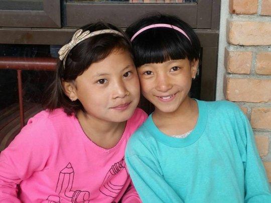 Maya (R) with her new sister Anjana (L).