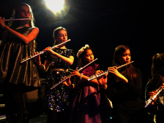 Young flute players playing New Orleans jazz