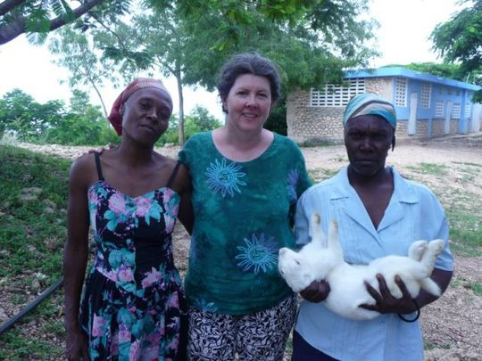 FTF Volunteer with rabbit producers